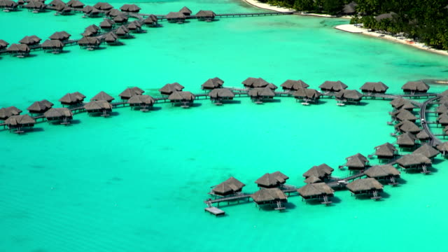 Aerial view overwater bungalow vacation resort Bora Bora