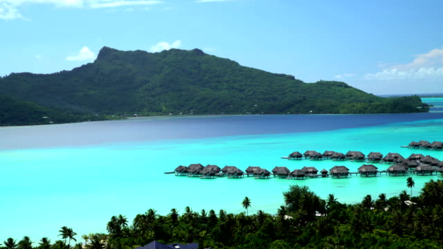 aerial view overwater bungalow vacation resort bora bora - tahiti video stock e b–roll