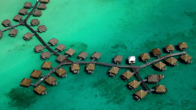 Aerial view overwater bungalow vacation resort Bora Bora