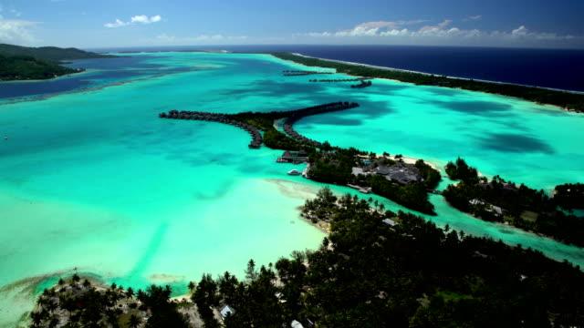aerial view overwater bungalow vacation resort bora bora - polynesian ethnicity stock videos & royalty-free footage