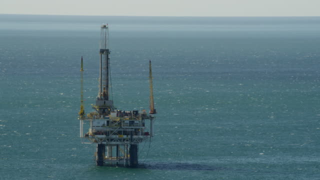 Aerial view Pacific Ocean gas drilling platform USA