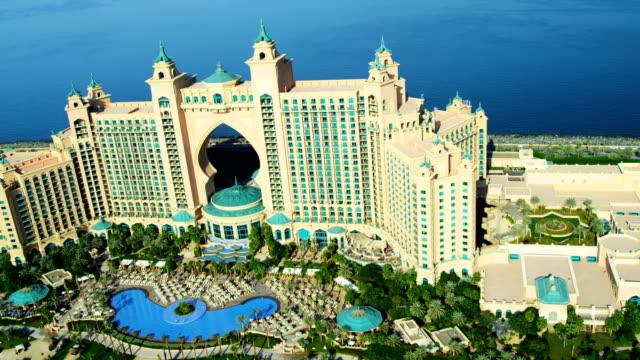 aerial view palm atlantis, dubai - tourist resort stock videos & royalty-free footage