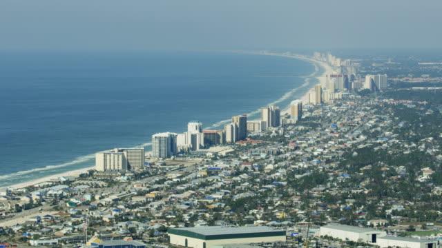 aerial view panama city beach hotel condominium resort - saint andrews bay video stock e b–roll
