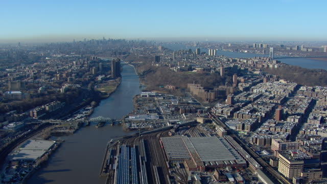 Aerial view panning over the Inwood neighborhood in Upper Manhattan between the Harlem River and the Hudson River in New York City.
