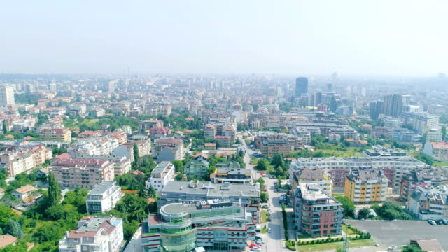 Aerial view panning wide shot of big city with air pollution