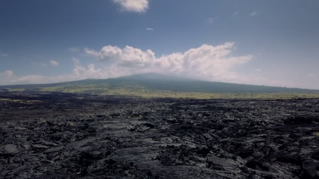 aerial view panorama of frozen lava of big island of hawaii, usa - big island hawaii islands stock videos & royalty-free footage