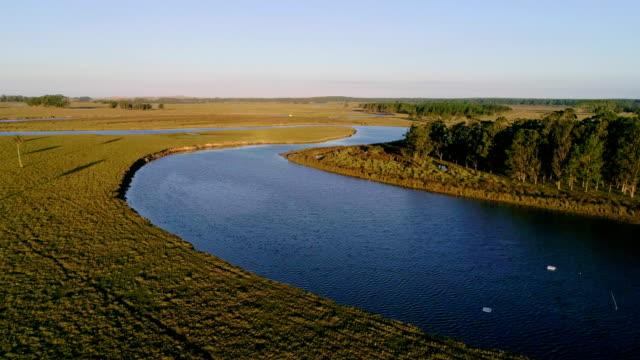 aerial view, paragliding over valizas creek, rocha department, uruguay - 鎮静薬点の映像素材/bロール