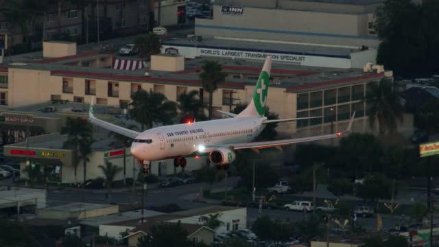 aerial view passenger plane over urban neighborhood la - aerospace stock videos & royalty-free footage