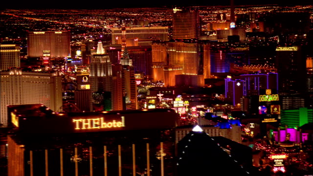 aerial view past mandalay bay hotel and luxor pyramid looking north at hotels along the las vegas strip / night / las vegas, nevada - the strip las vegas stock-videos und b-roll-filmmaterial