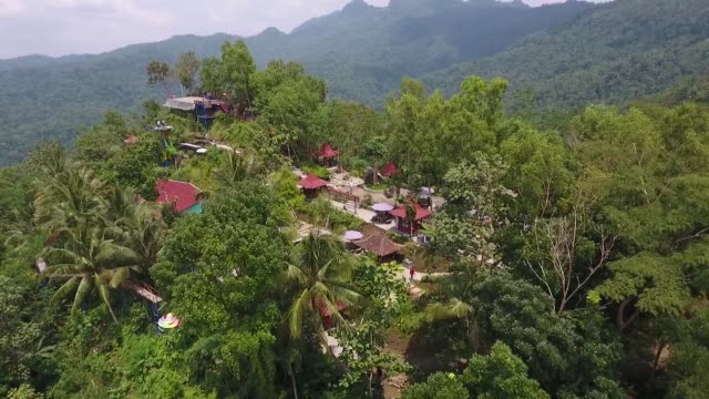 Aerial view people are seen walking through the Pule Payung Tourism Hill attraction in this aerial video taken above Kulon Progo Regency Special...