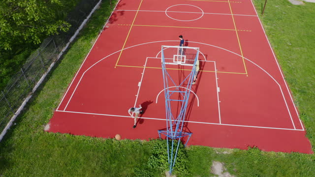 aerial view people playing basketball on outdoors court - angle stock videos & royalty-free footage