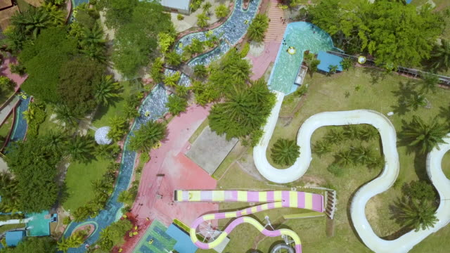 aerial view people playing in swimming pool - amusement park stock videos & royalty-free footage