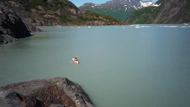 Aerial View Person Kayaking in Bay in Alaska