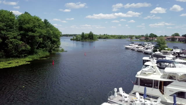 aerial view :pleasure boats moored on lake huron - pier stock videos & royalty-free footage