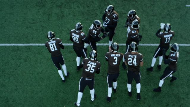 MS PAN Aerial view Professional football team in huddle and coming to line of scrimmage