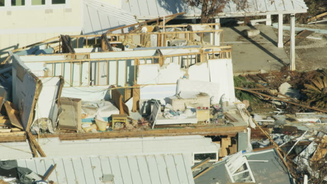 aerial view property destroyed by category 4 hurricane - vortex stock videos & royalty-free footage