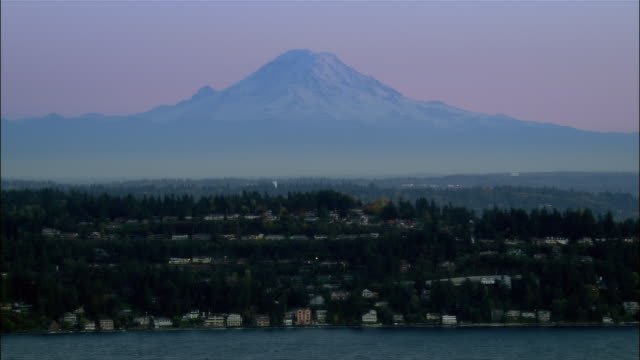 aerial view puget sound coastline with mount ranier in background / seattle, washington - puget sound stock videos & royalty-free footage