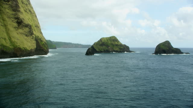 aerial view rainforests waterfalls green shoreline big island - jurassic stock videos & royalty-free footage