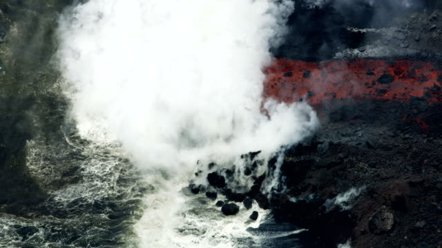 aerial view red hot lava pouring into pacific - pazifik stock-videos und b-roll-filmmaterial