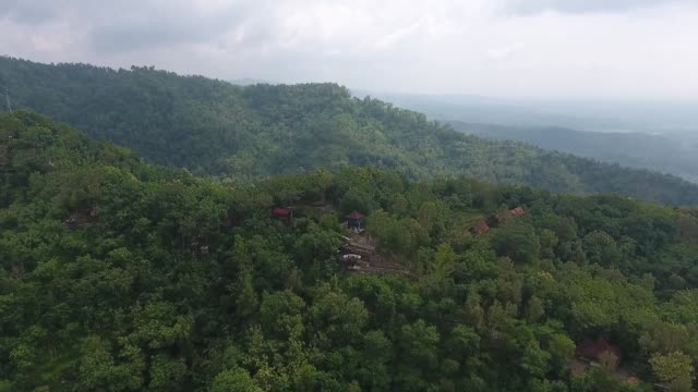 Aerial view reverse track visitors pose for photographs on a platform at the Kalibiru Tourism Village in this aerial video taken at Kulon Progo...