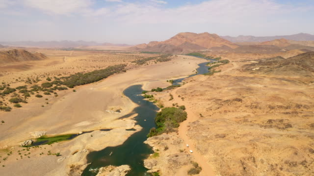 ws aerial view river through sunny vast desert, namibia, africa - heat stock videos & royalty-free footage