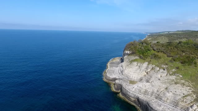 aerial view rock cliffs on a coastline - steep stock videos & royalty-free footage