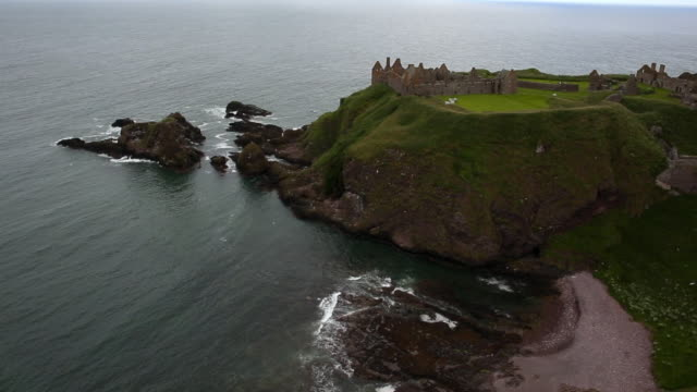 aerial view rocky headland with dunnottar castle in aberdeenshire, scotland - scotland stock videos & royalty-free footage