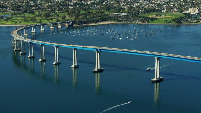 aerial view san diego coronado bridge tidelands park - harbour stock videos & royalty-free footage