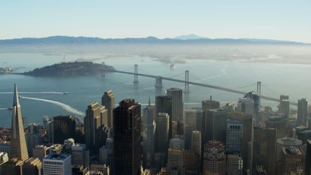 aerial view san francisco california oakland bay bridge - baia di san francisco video stock e b–roll