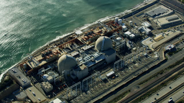 aerial view san onofre nuclear power plant california - kernenergie stock-videos und b-roll-filmmaterial