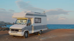 Aerial view. Scenic Sea. Modern Motorhome Rv on the Sea Coast. Concept Vacation on the Road. Timelapse