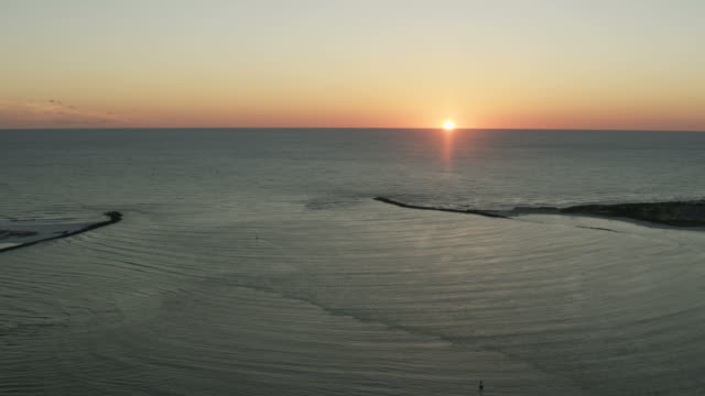 aerial view setting sun saint andrews bay harbor - saint andrews bay video stock e b–roll