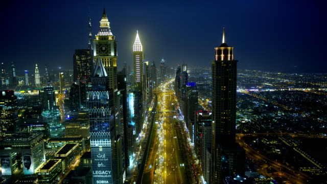 aerial view sheikh zayed road night skyscrapers dubai - travel destinations stock videos & royalty-free footage