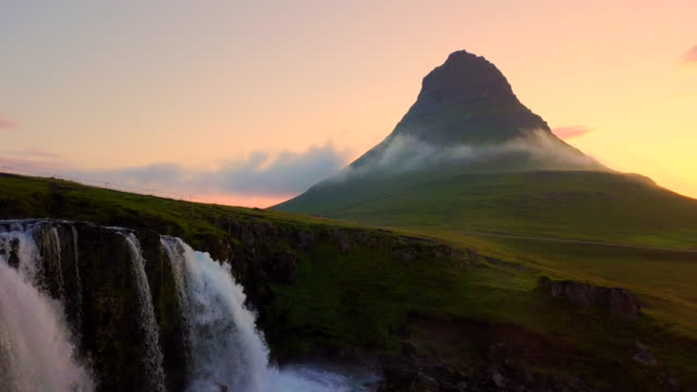 aerial view shot in the morning of kirkjufell mountain at summer in western iceland - waterfall stock videos & royalty-free footage