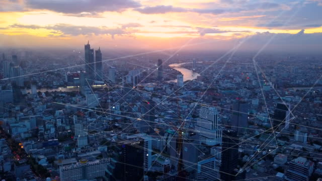 Aerial view shot of Bangkok city at dusk with communication network