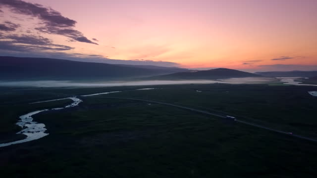 Aerial view shot of Beautiful mountain and meadow with foggy in evening at Iceland