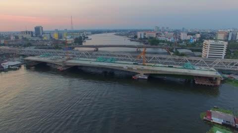 aerial view shot of bridge construction site - bridge built structure stock videos & royalty-free footage