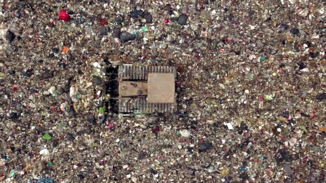 aerial view shot of garbage dump landfill - toxic waste stock videos & royalty-free footage