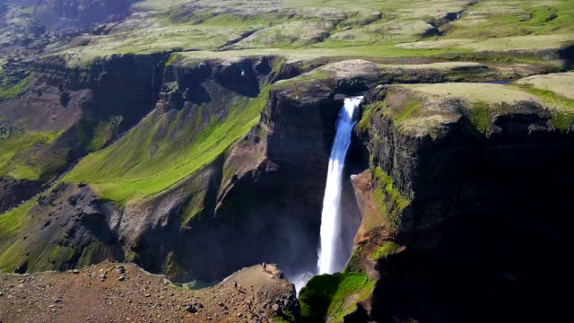 Aerial view shot of Haifoss Waterfall at summer in Iceland