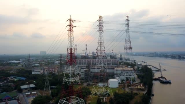 stockvideo's en b-roll-footage met luchtfoto schot van hoogspanning pole - stroomtransformator