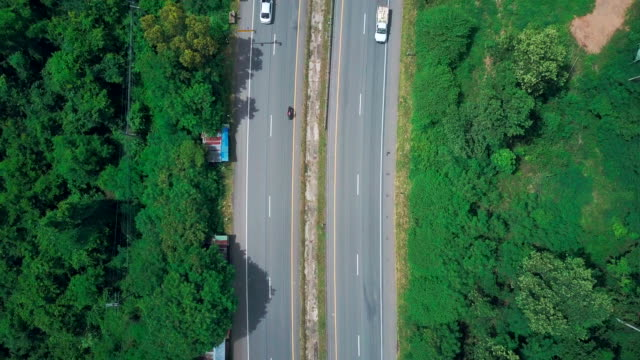 aerial view shot of highway through the countryside - road construction stock videos and b-roll footage