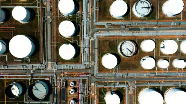 aerial view shot of large oil refinery facilities and storage tank - fuel crisis stock videos and b-roll footage
