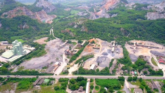 Aerial view shot of Mine and heavy equipment limestone crusher and truck