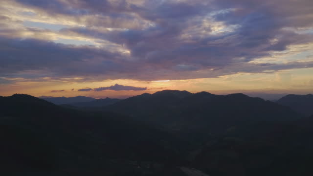aerial view shot of sunset over mountain at countryside in north thailand - wilderness stock videos and b-roll footage