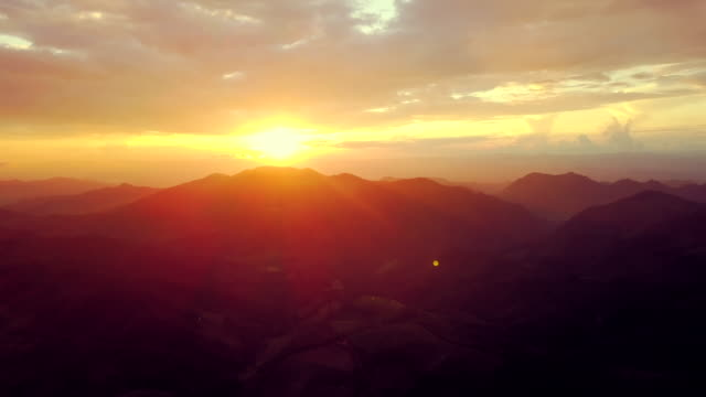 Aerial view shot of sunset over mountain at countryside in north Thailand