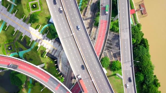 stockvideo's en b-roll-footage met luchtfoto schot van verkeer snelweg in thailand - bovenste deel