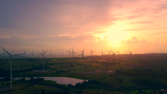Aerial view shot of Wind turbines at evening- renewable energy