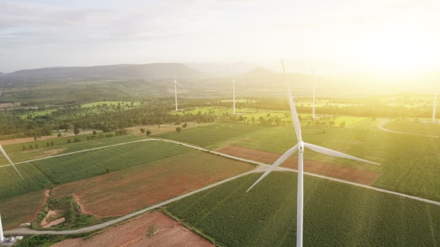 aerial view shot of wind turbines at morning - energia rinnovabile video stock e b–roll