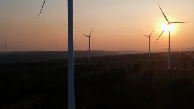 Aerial view shot of Wind turbines at sunset