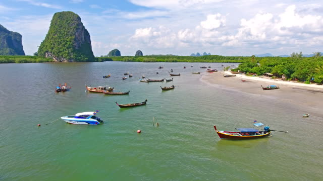 aerial view shot tropical beach sea with long tail boat in south thailand - krabi province stock videos & royalty-free footage